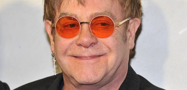 Elton in orange glasses