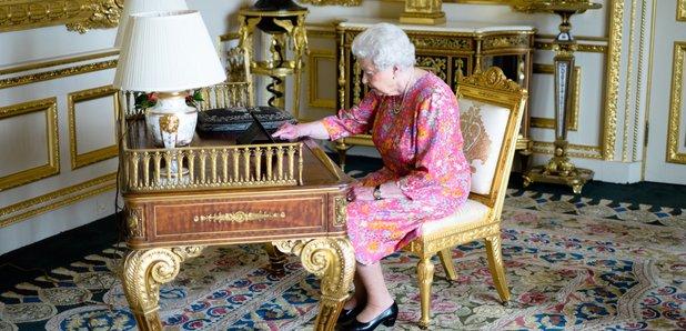 The Queen tweeting