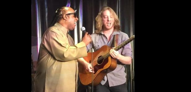 Stevie Wonder and busker sing together